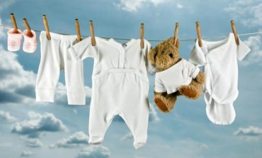 Come scegliere la  misura per gli abiti del neonato
